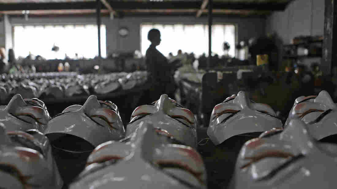 A woman cleans Guy Fawkes masks, used by many demonstrators in protests around the world and in the recent wave of demonstrations in Brazil, at a factory assembly line in Sao Goncalo, near Rio de Janeiro, June 28.