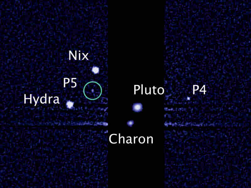 Pluto's two newest moons, designated as P4 and P5 in this image from the Hubble Space Telescope, will now be called Kerberos and Styx.