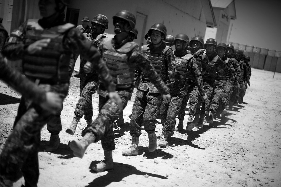 ANA troops march in formation during a morning training exercise at Combat Outpost Arian in Ghazni province. Cunningham sees a new willingness to take on the Taliban and an eagerness to learn about what the ANA will face. (NPR)