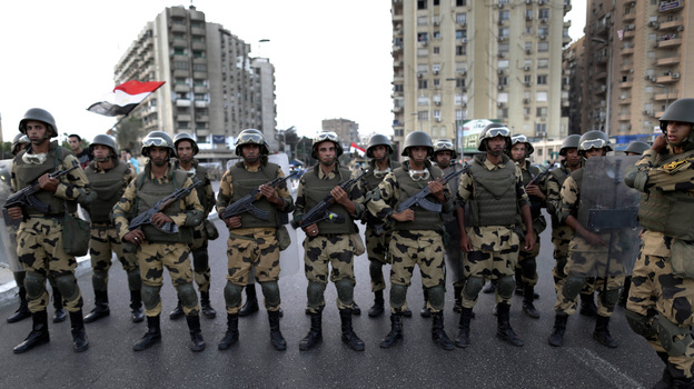 Military special forces surround supporters of President Mohammed Morsi in Cairo on Wednesday. A few hours later, the military ousted Morsi and suspended the constitution. (AP)