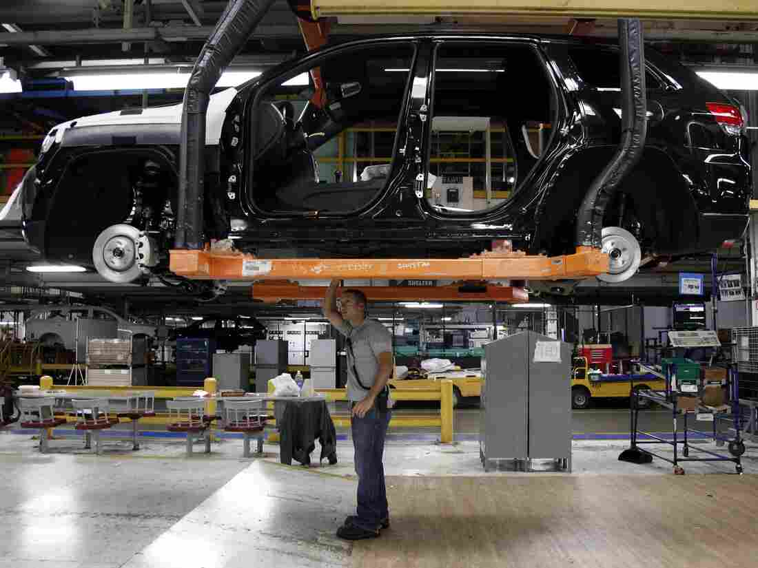 Jeff Caldwell checks a vehicle on the assembly line at the Chrysler Jefferson North Assembly plant in Detroit in May. U.S. auto sales rose last month to their fastest pace since 2007.