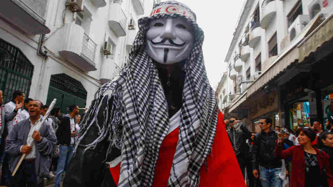 Tunis, Tunisia: A man wears an Anonymous mask during a May Day rally on May 1.
