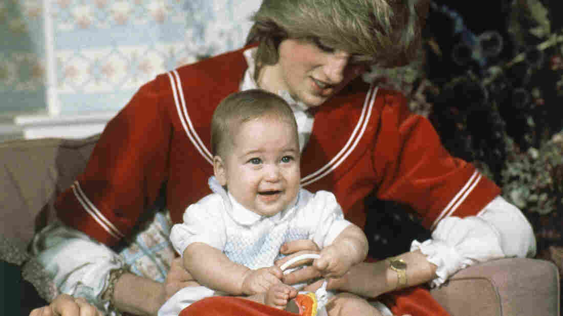 Britain's Prince William, the 6-month-old son of Prince Charles and Princess Diana, sits on his mother's knee at Kensington Palace in London on Dec. 22, 1982.