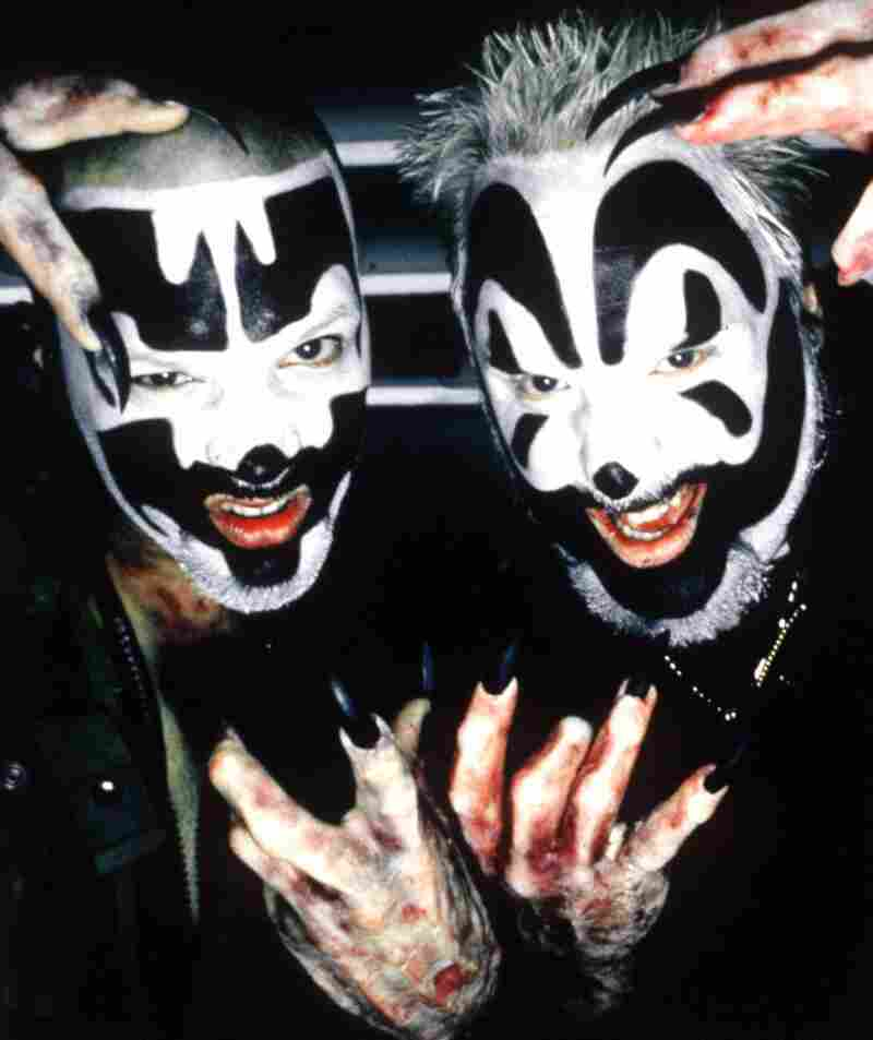 Shaggy 2 Dope, left, and Violent J make of the rap duo Insane Clown Posse, seen here in their stage makeup in 1999.
