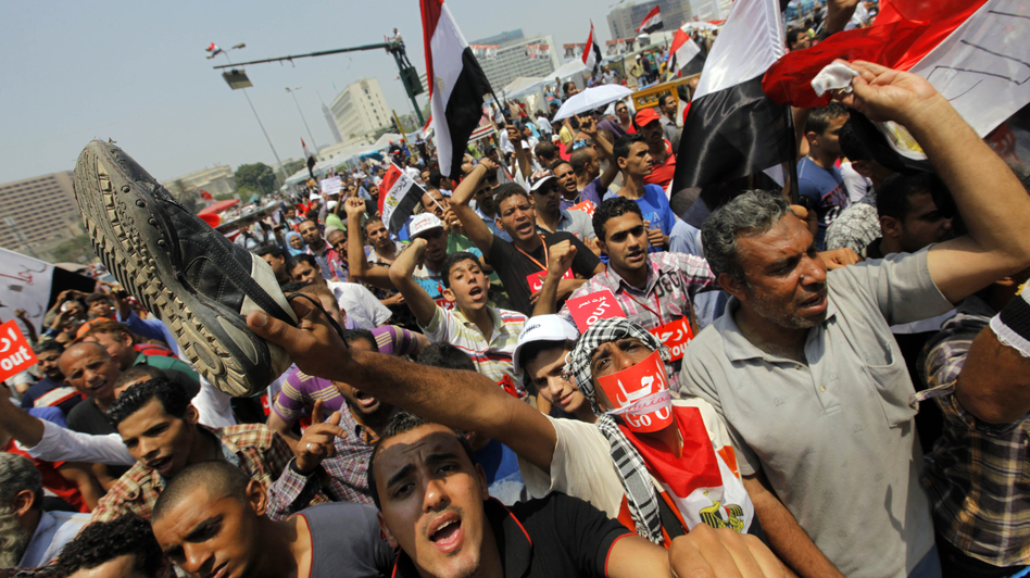 Protesters gather at Tahrir Square. Morsi remained defiant as the military pressed the president and his political opponents to strike a compromise. (AP)