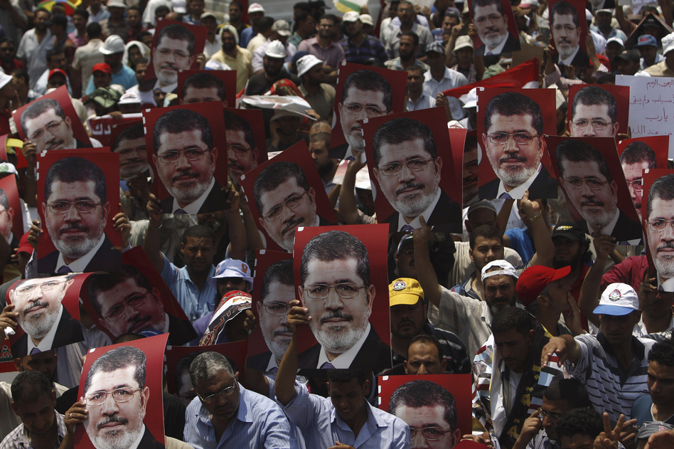 Supporters hold up posters of Morsi during a rally at the Raba El-Adwyia mosque square in Cairo. (Reuters/Landov)