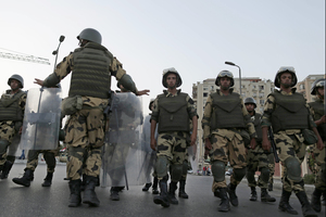 Military special forces surround Morsi supporters in Nasr City, Cairo. Army troops deployed across much of Cairo, near protest sites and at key facilities and major intersections.