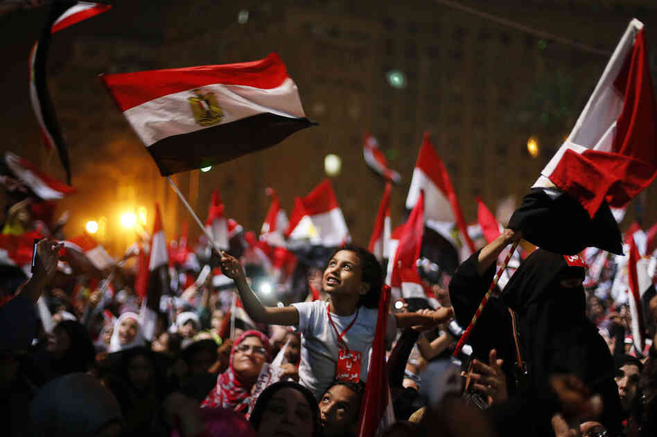 Protesters in Cairo's Tahrir Square react after President Mohammed Morsi was ousted by the military on Wednesday. The head of Egypt's armed forces, Gen. Abdel Fattah al-Sisi, issued a declaration suspending the constitution and appointing Egypt's chief justice as interim head of state.