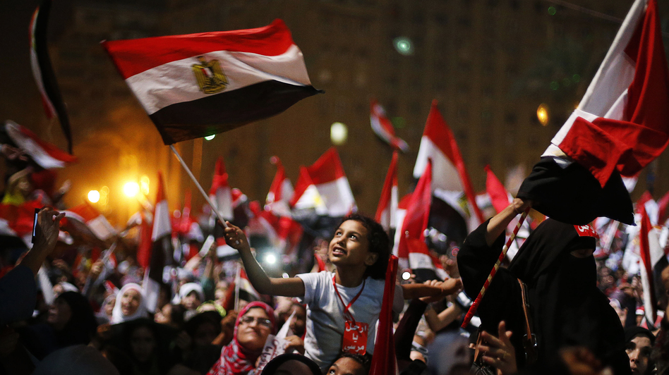 Protesters in Cairo's Tahrir Square react after President Mohammed Morsi was ousted by the military on Wednesday. The head of Egypt's armed forces, Gen. Abdel Fattah al-Sisi, issued a declaration suspending the constitution and appointing Egypt's chief justice as interim head of state. (Reuters/Landov)
