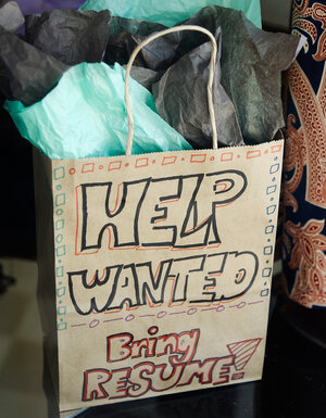 A help wanted sign in the window of a clothing store in Pasadena, Calif., last month.