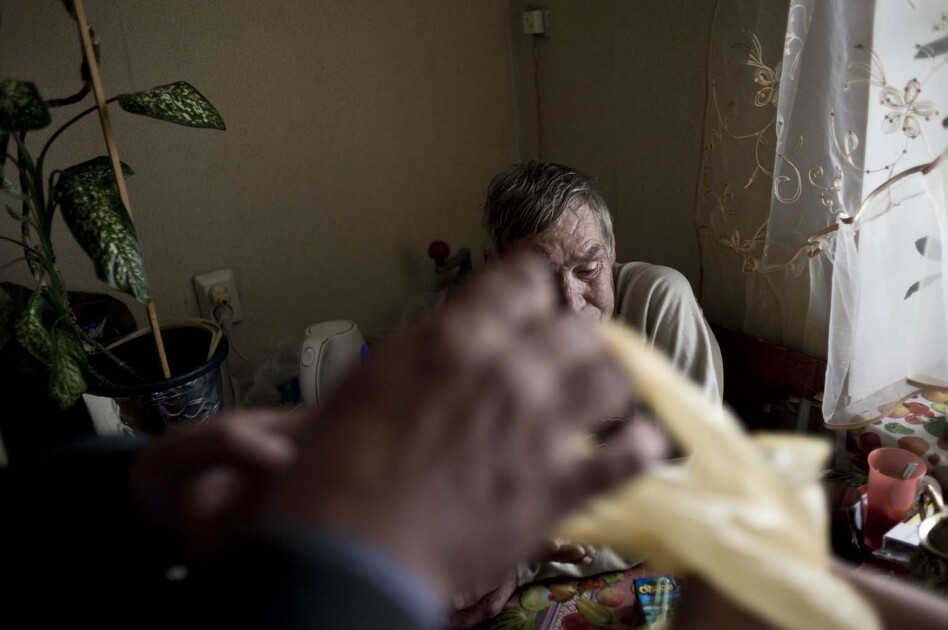 Sputnik nurses visit patients, such as Anatoliy Kharkov, twice each day to give them anti-TB medications. (Konstantin Salomatin/for NPR)