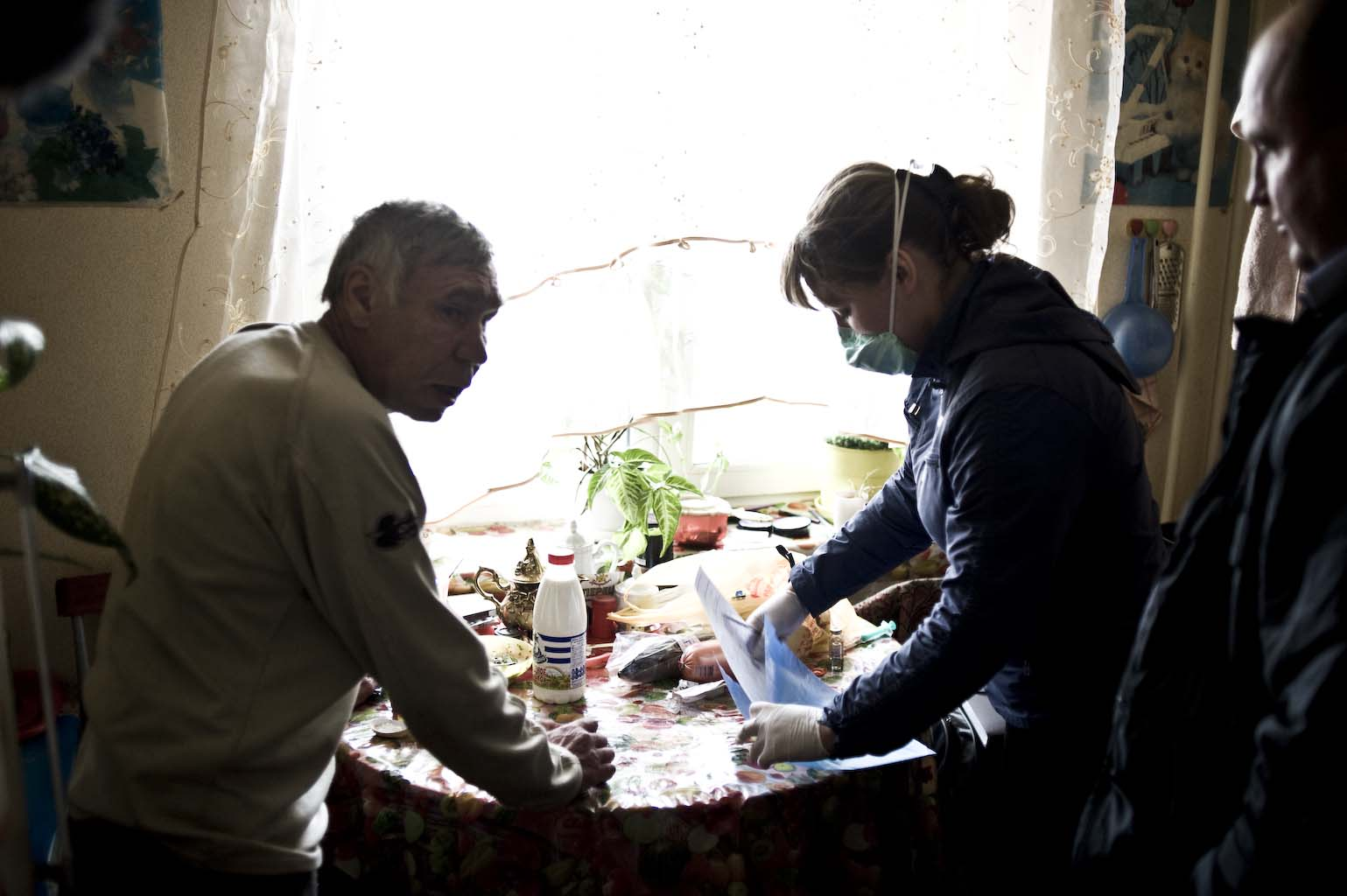 Safronova brings Kharkov food and anti-TB medications at his home in Tomsk.