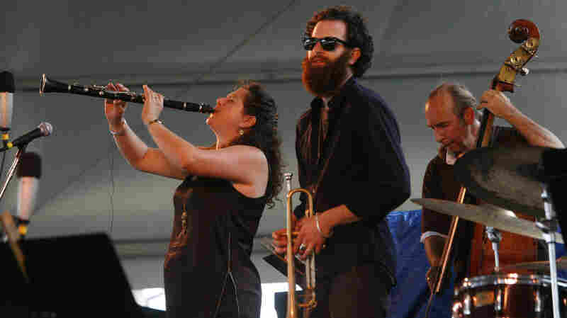 Anat Cohen (left) performs with Avishai Cohen (center) at the Newport Jazz Festival.