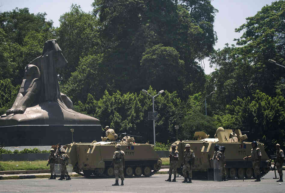 Armored personnel carriers are stationed outside the Giza Zoo on the road leading to Cairo University, where supporters of the Morsi and the Muslim Brotherhood are camped.