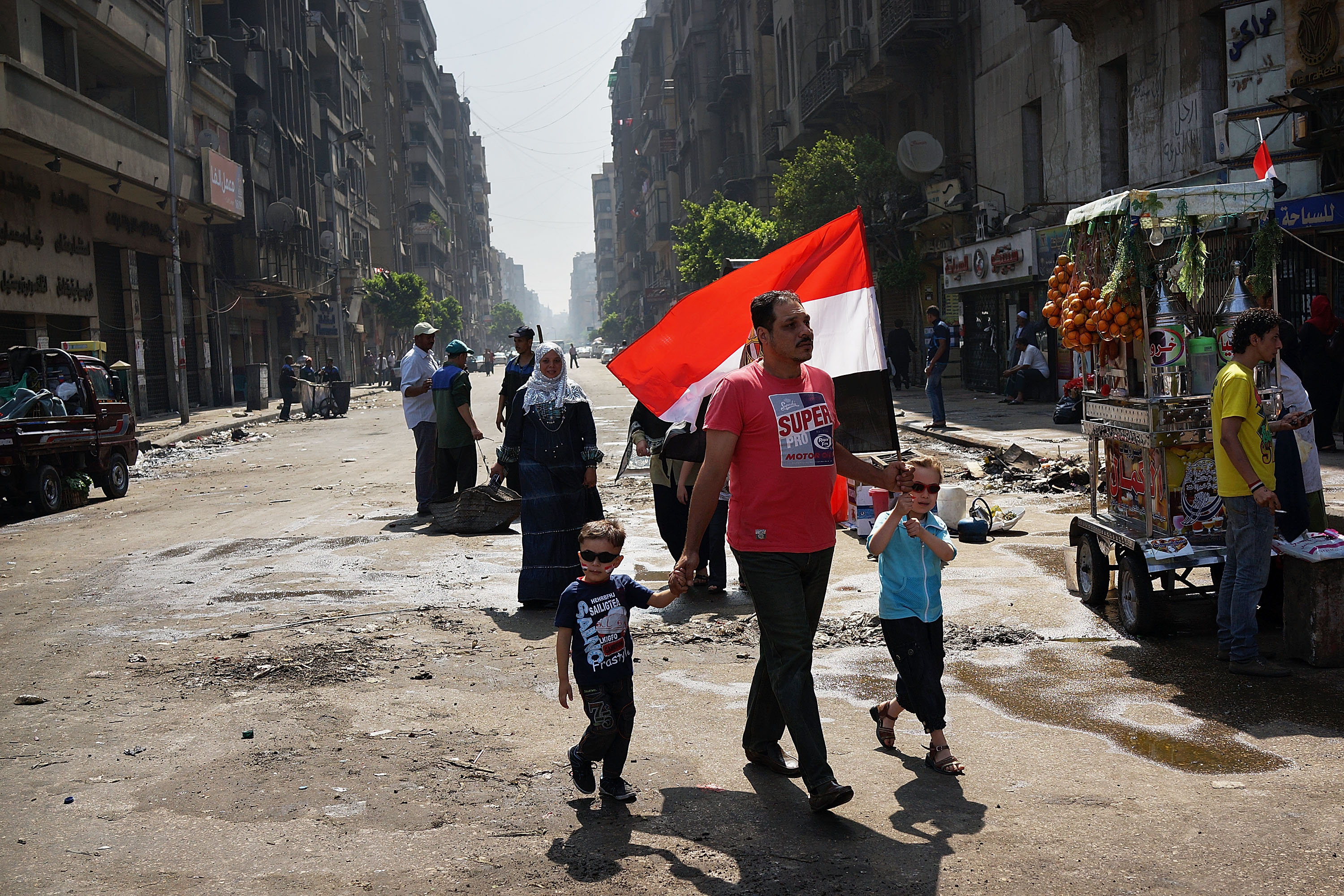 A family walks to Tahrir Square the morning after Morsi was ousted from power and put under house arrest.