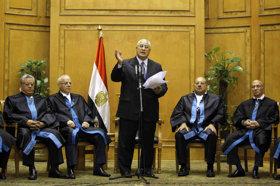 Egypt's chief justice Adly Mansour (center) speaks at his swearing-in ceremony as the nation's interim president on Thursday.