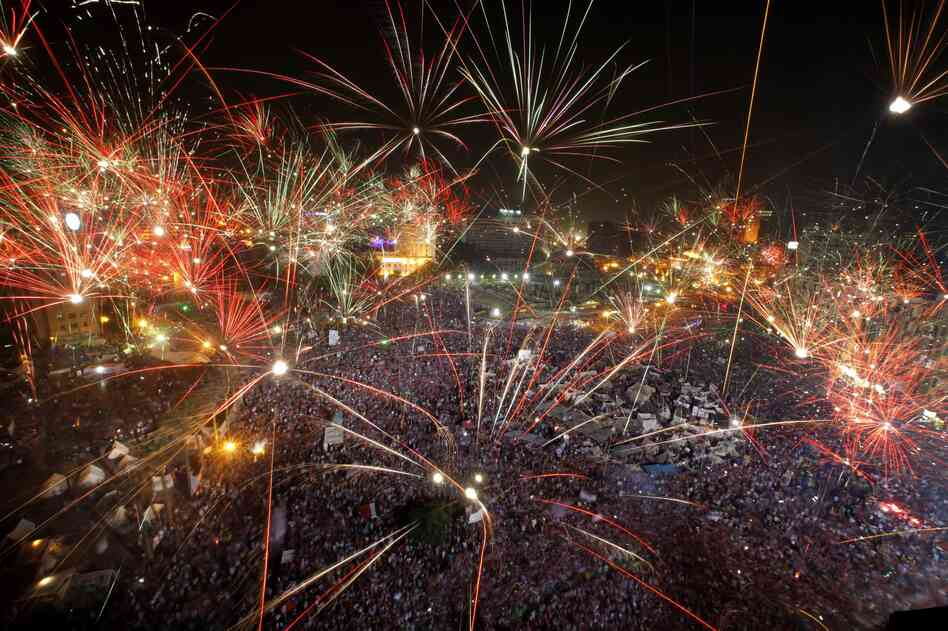 Fireworks light the sky opponents of Egypt's Islamist President Mohammed Morsi celebrate in Tahrir Square.
