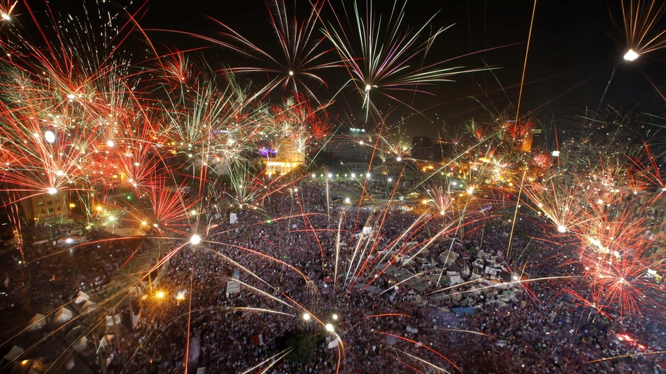 Fireworks light the sky opponents of Egypt's Islamist President Mohammed Morsi celebrate in Tahrir Square. (AP)
