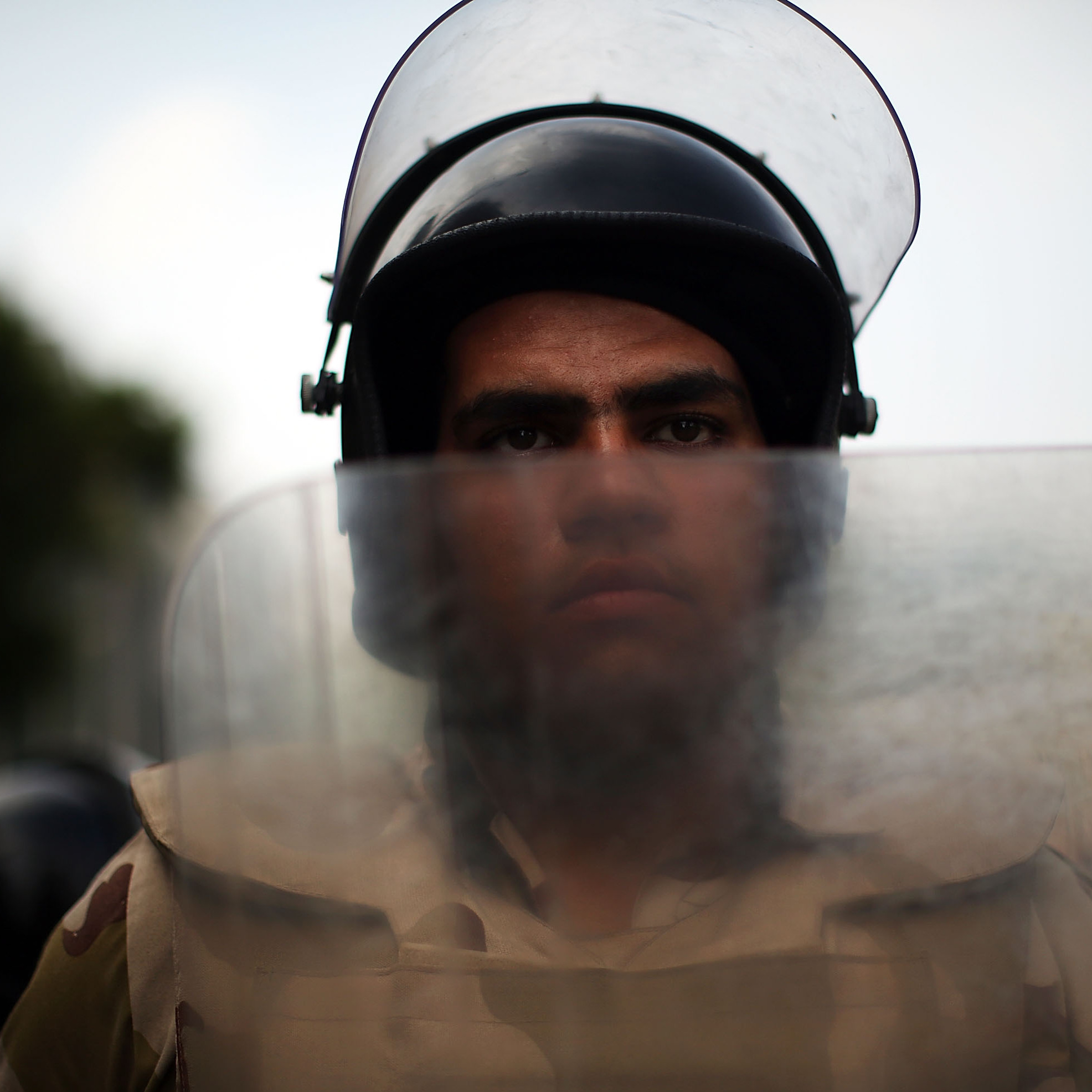In Cairo, this soldier was among many standing guard at roadblocks Thursday as authorities moved to try to prevent violence while also seeking to arrest hundreds of Muslim Brotherhood members.