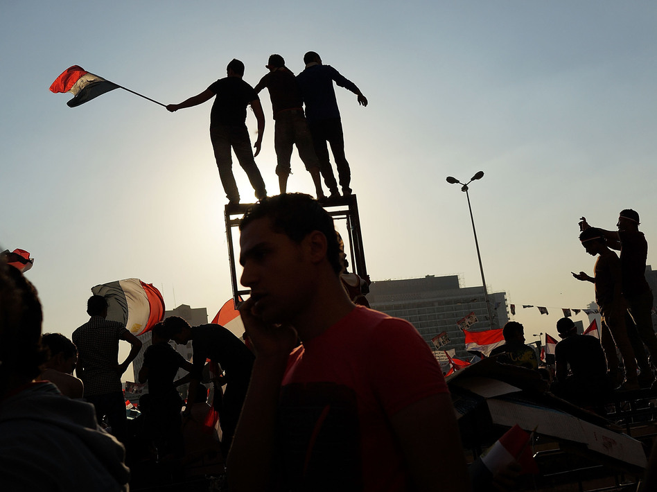People dance and cheer in Cairo's Tahrir Square on July 4, the day after former Egyptian President Mohammed Morsi was ousted from power. (Spencer Platt/Getty Images)