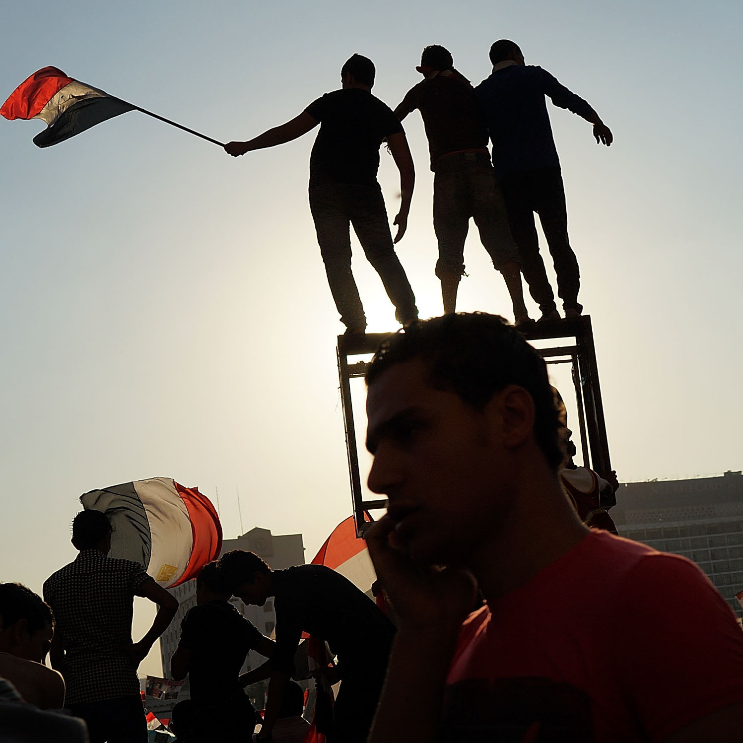 People dance and cheer in Tahrir Square on July 4, the day after former Egyptian President Mohammed Morsi, the country's first democratically elected president, was ousted from power on July 4, 2013 in Cairo, Egypt.
