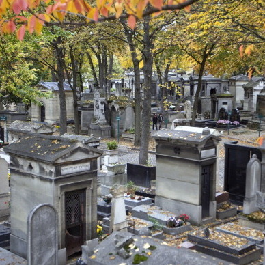 "People pass by graves at the Montmartre cemetery in Paris on Oct. 30, 2011, two days ahead of the catholic ""All Saints"" event."