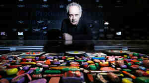 Catalan chef Ferran Adrià poses with plasticine models of his food on display at Somerset House in London. A new exhibit looks back at the influential modernist chef and his landmark restaurant, El Bulli.