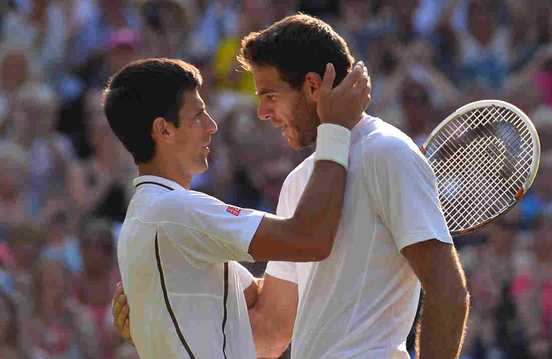 Serbia's Novak Djokovic (left) embraces Argentina's Juan Martin Del Potro after their match on day 11 of the 2013 Championships at Wimbledon.
