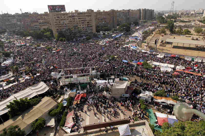 Protesters supporting deposed Egypt's President Mohamed Morsi gather at the Raba El-Adwyia mosque square, near the Republican Guard barracks where Mursi is being held, in Cairo on July 5. At least three protesters were shot dead outside the barracks in Cairo, security sources said, as angry Islamist supporters confronted troops across the country.
