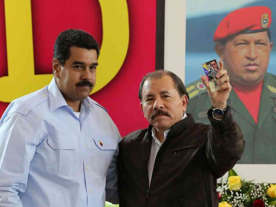 Nicaraguan President Daniel Ortega (right) and his Venezu