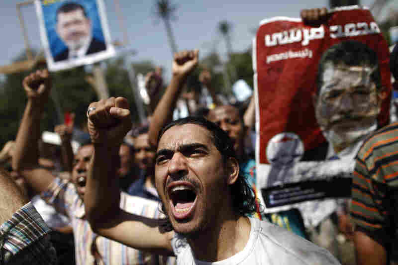 Supporters of the Muslim Brotherhood and ousted President Mohammed Morsi protest near Cairo University on Friday. A wave of mass rallies against the military's ouster of Morsi are expected.