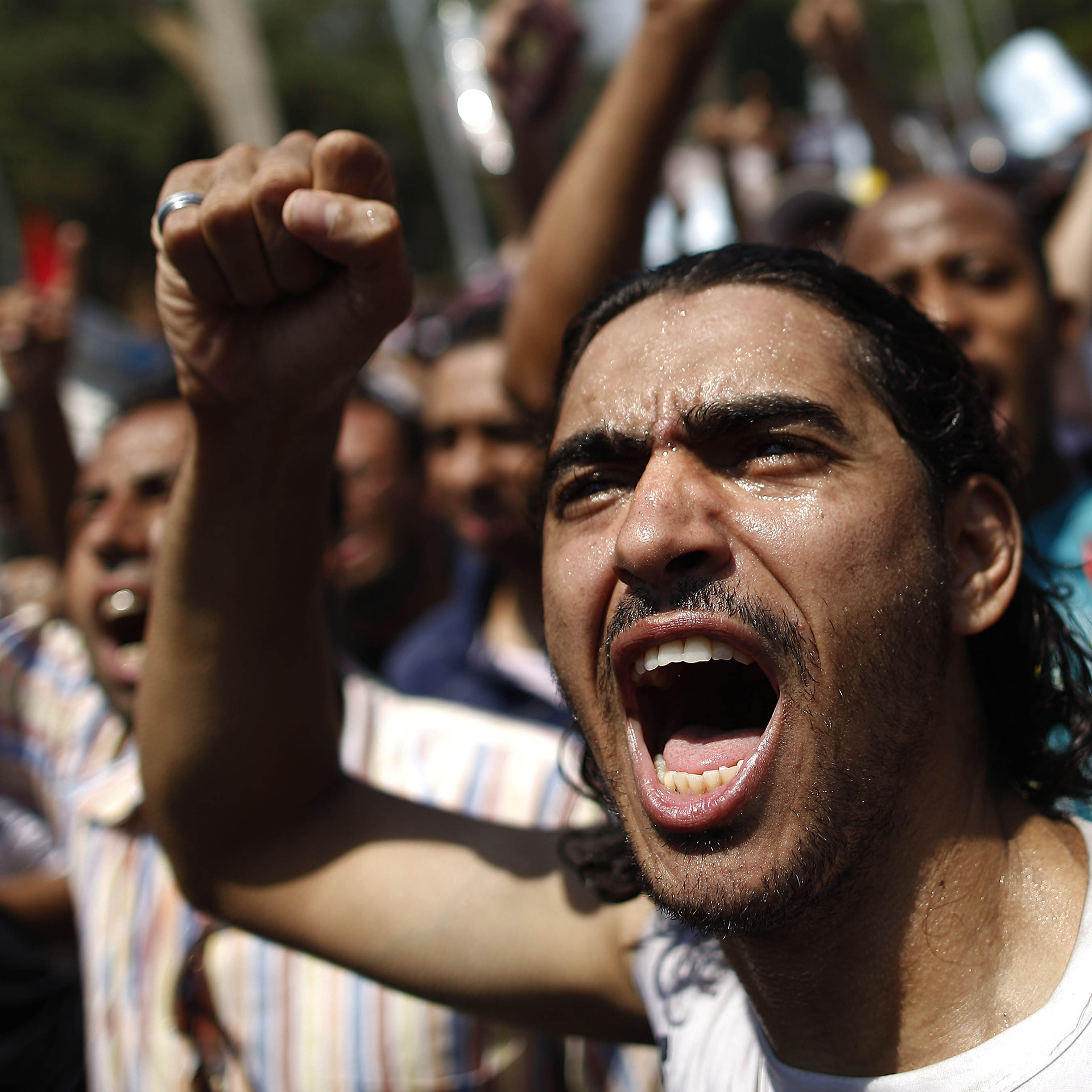 An Egyptian supporter of the Muslim Brotherhood and ousted President Mohammed Morsi protest near Cairo University on Friday.