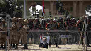 Egyptian soldiers stand guard outside the Republican Guard building in Cairo on Friday. Egyptian troops clashed with mostly Islamist protesters demanding the restoration of the ousted president, Mohammed Morsi.