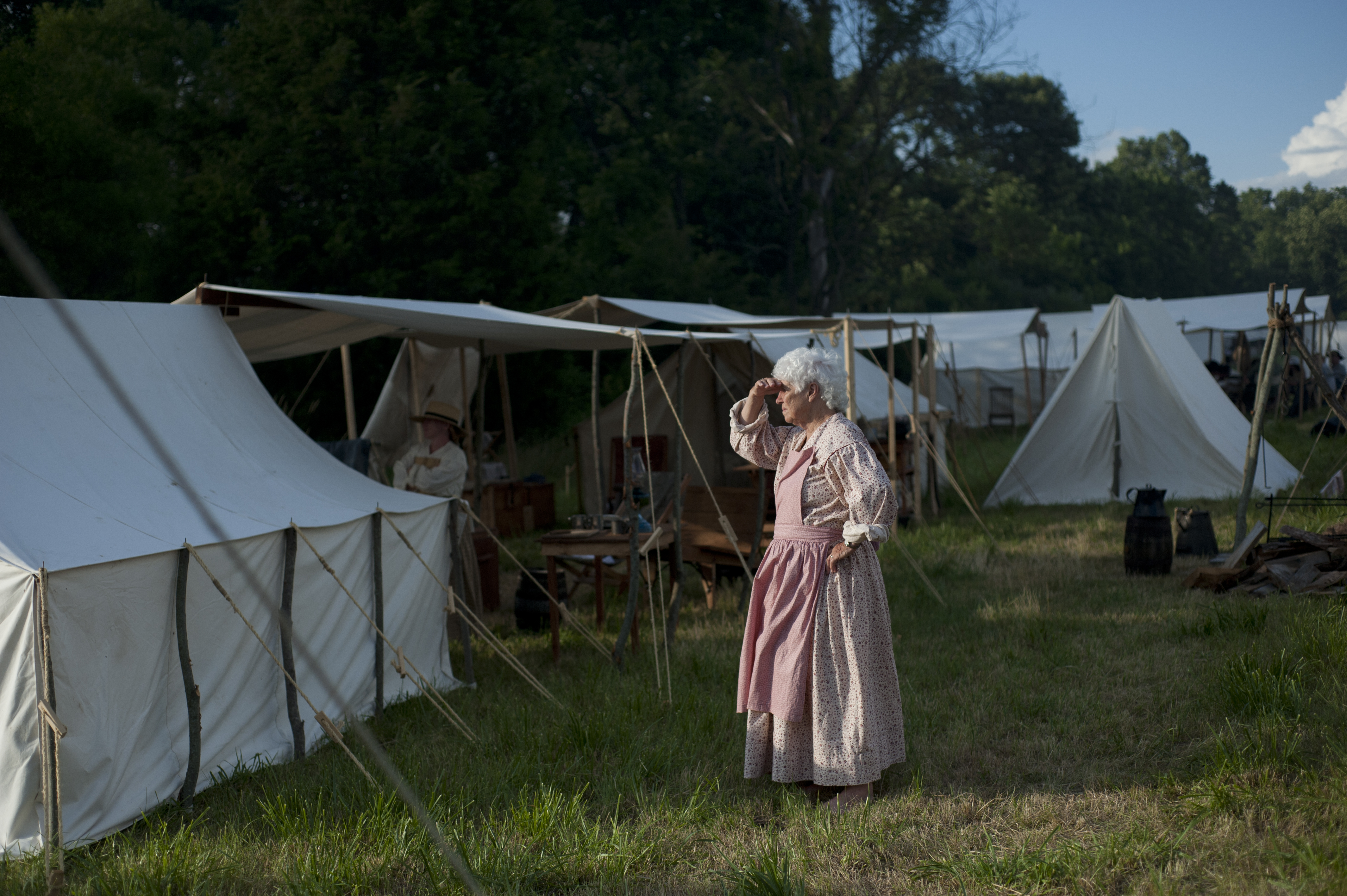 A women observes the battlefield from the Union Army camp. The fight had moved directly adjacent to the camp.
