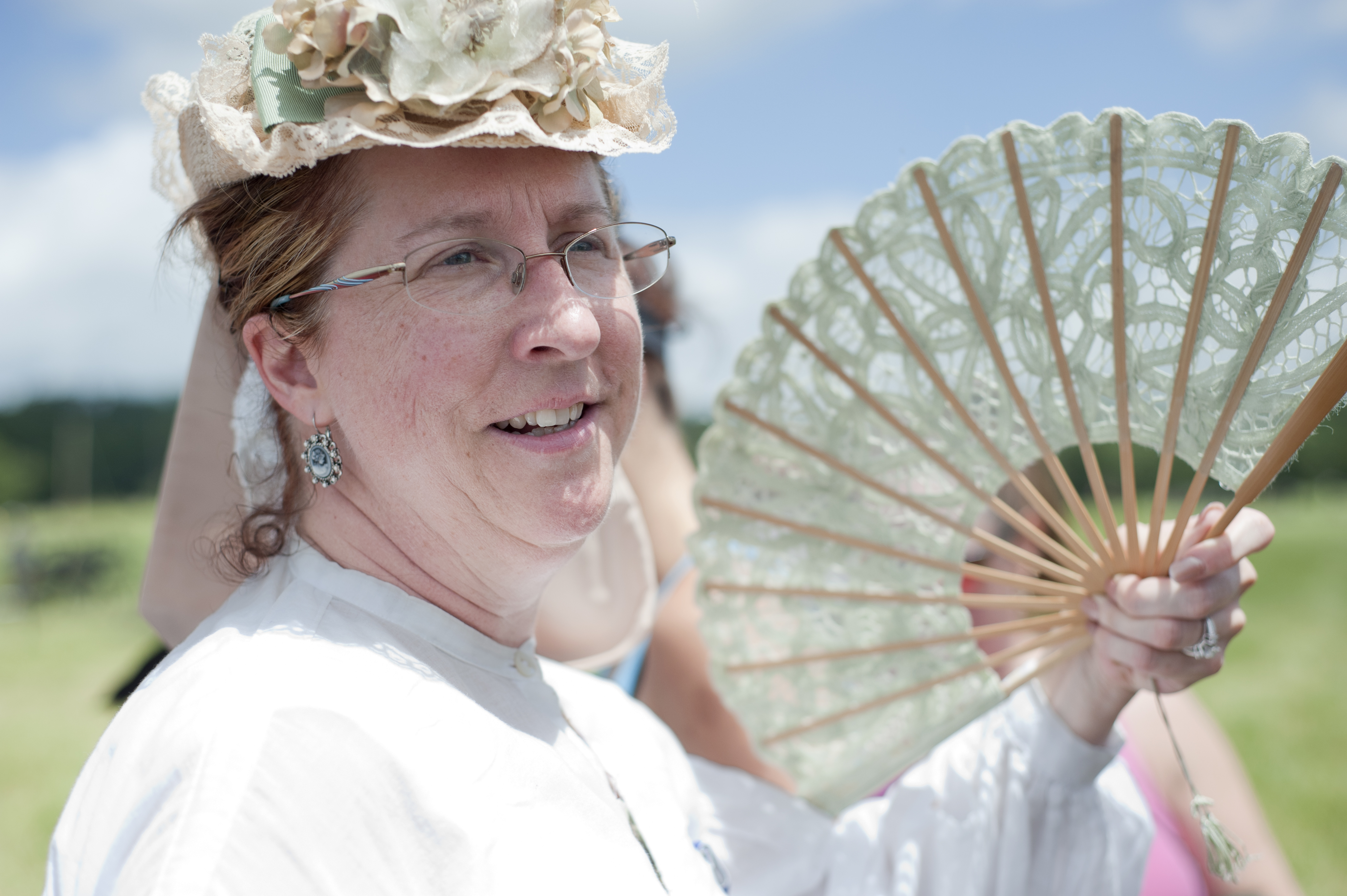 Leeanne Boles, of California, fans herself from the sidelines of the battlefield. Her fiance� was portraying a Confederate lieutenant.