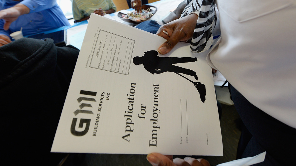 At a job fair in Los Angeles last month, job seekers filled out applications. (Getty Images)
