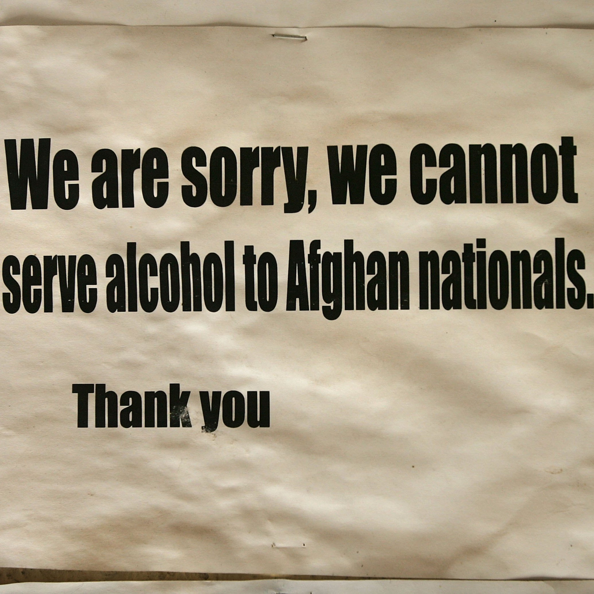 A sign posted at the entrance of a French restaurant in Kabul (from February 2006) highlights one of the many vagaries of rules governing alcohol in Afghanistan and elsewhere in the Muslim world.