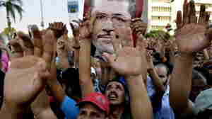 Egyptian supporters of the Muslim Brotherhood hold pictures of deposed President Mohammed Morsi in Cairo on Friday.