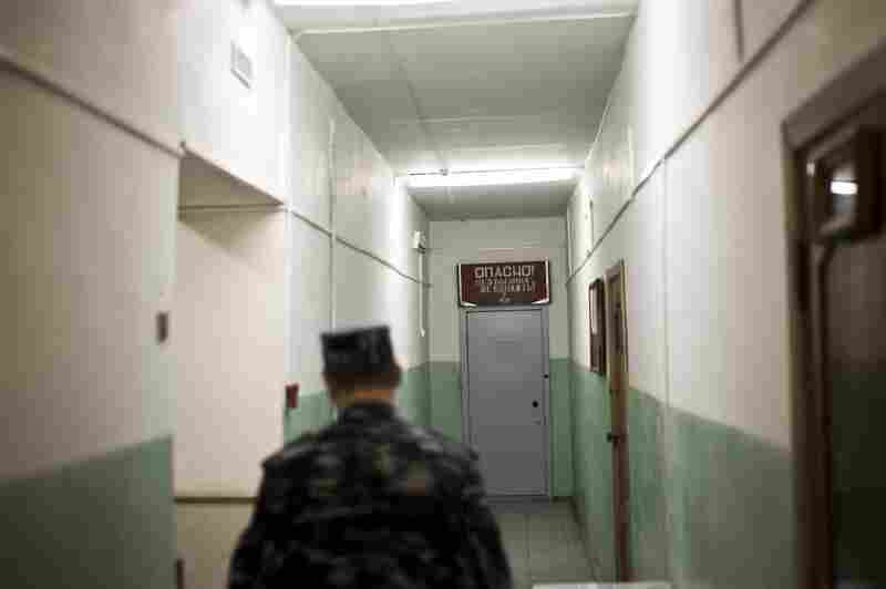 A warden walks the halls of the TB prison in Tomsk, Russia.