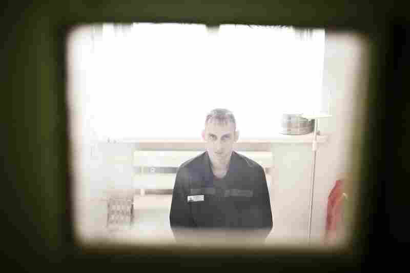 Igor Davydenko sits in his cell at a prison in Tomsk, Russia, where inmates are sent for tuberculosis treatment.