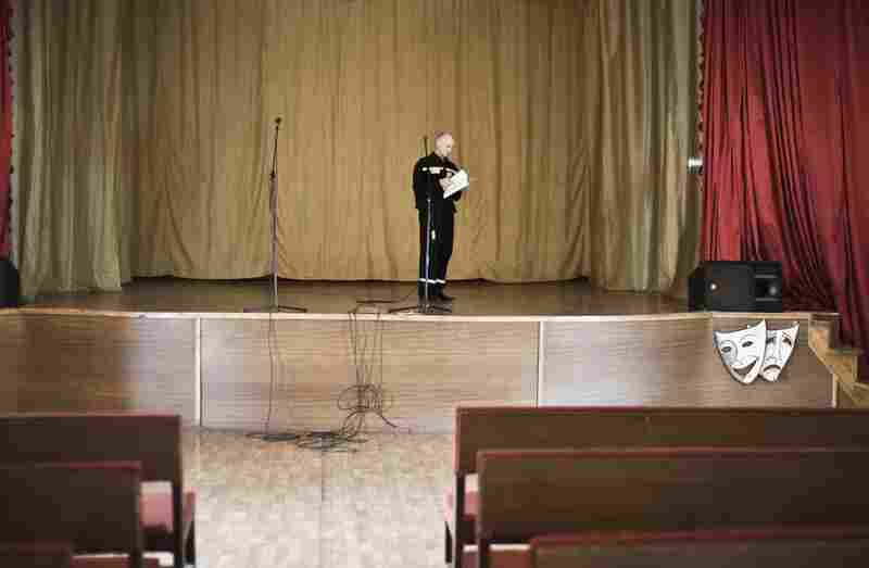 An inmate practices for the yearly talent show in the prison's concert hall. Such cultural activities are part of the hospital's treatment, which combines correction with education, medical and psychological therapy.