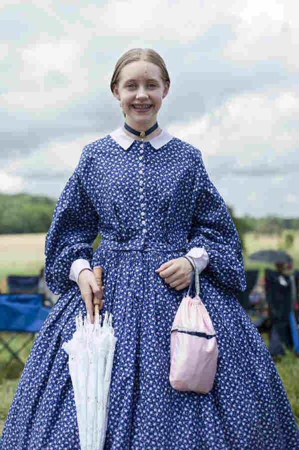 "Amara Jachim, 12, of Michigan, poses in her Civil War-era costume. ""It gets pretty hot but it's still fun to wear,"" she said."