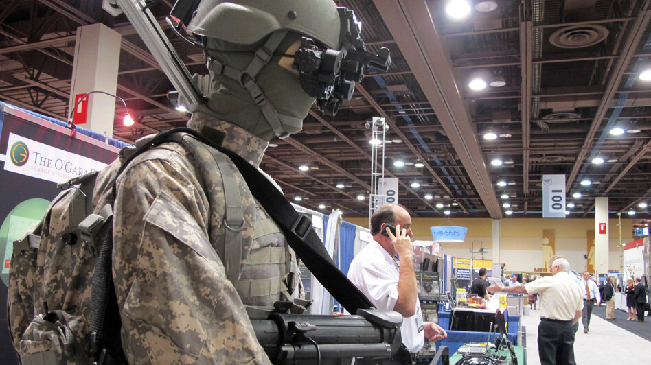 A mannequin in night-vision goggles is part of a display at a border-security expo in Pheonix last year. Defense companies are seeking growth in markets in the developing world, or in homeland and cybersecurity. (Amanda Meyers/AP)