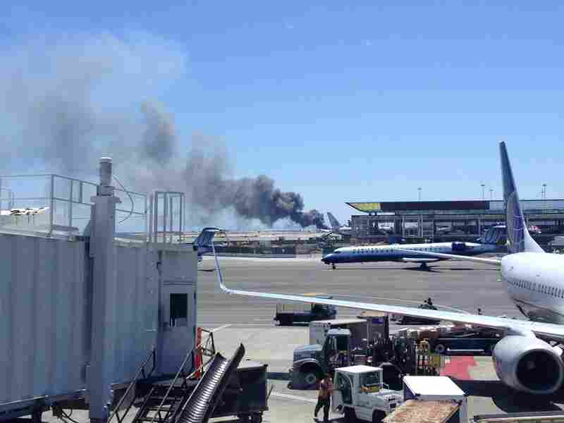 """A photo of the aircraft provided by Zach Custer. One witness inside the terminal said travelers couldn't hear the crash, but as soon as they saw the plane """"there was just a lot of uncertainty and commotion."""""""