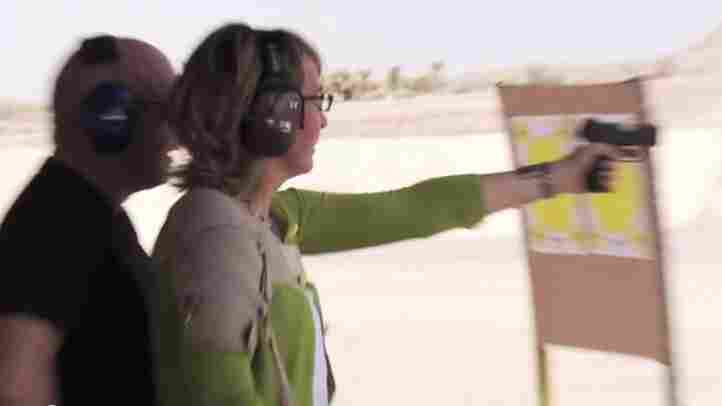 Former Rep. Gabrielle Giffords, D-Ariz., at a firing range in Nevada earlier this week. Her husband, retired astronaut Mark Kelly, was behind her.