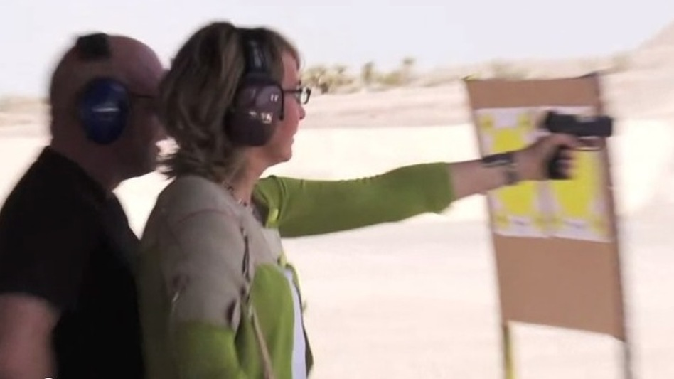 Former Rep. Gabrielle Giffords, D-Ariz., at a firing range in Nevada earlier this week. Her husband, retired astronaut Mark Kelly, was behind her. (Americans for Responsible Solutions)
