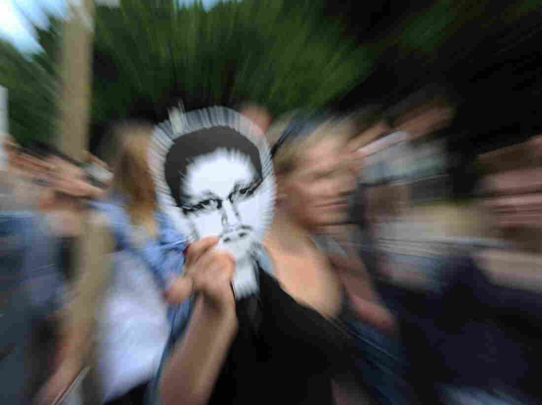 Former National Security Agency contractor Edward Snowden, who spilled secrets about the NSA's surveillance programs, has been condemned by U.S. officials. But he's been praised by some people around the world. In Berlin this week, supporters carried his picture at a demonstration.
