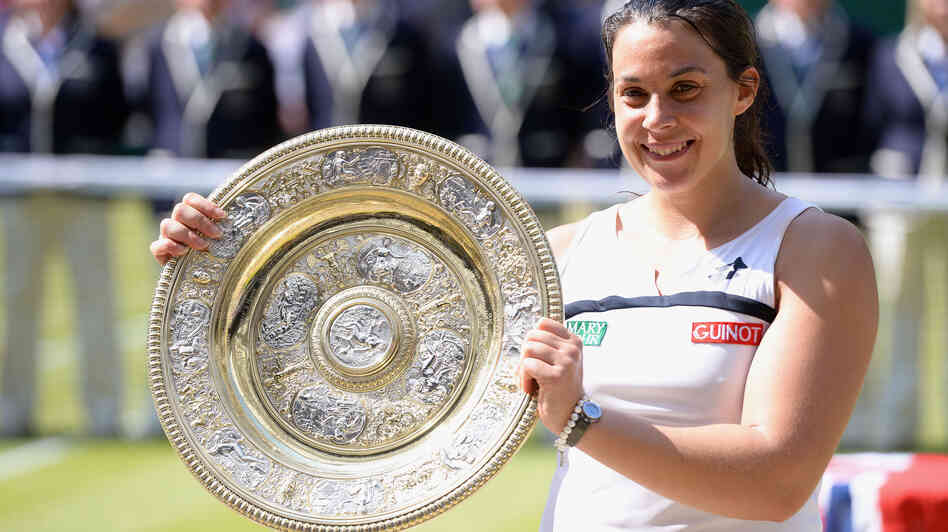 France's Marion Bartoli celebrates her Wimbledon women's singles championship. The BBC has apologized to Bartoli