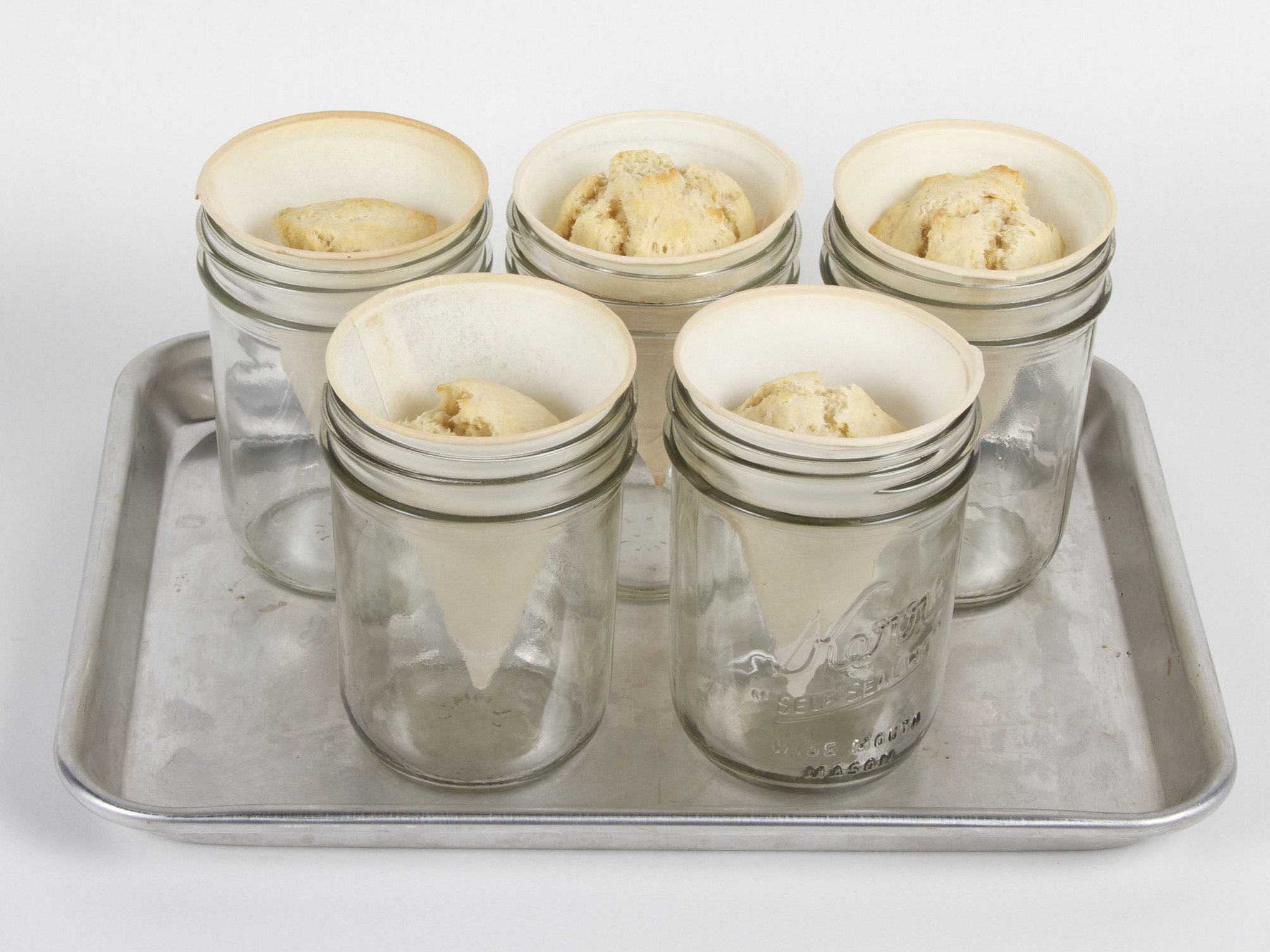 To create the cone-shaped scones, you'll need to use conical water cooler cups as baking wrappers. These scones were placed in canning jars to hold them upright during baking. For full baking instructions, see here.