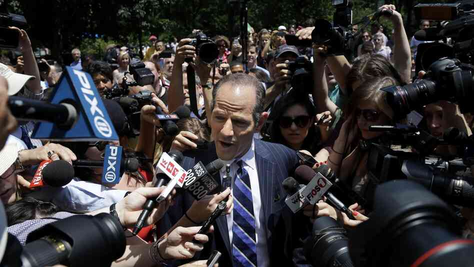 Eliot Spitzer is surrounded by media Monday as he tries to collect signatures for his run for New York City comptroller. The former governor, who stepped down in 2008 amid a prostitution scandal, says he is planning a political comeback.
